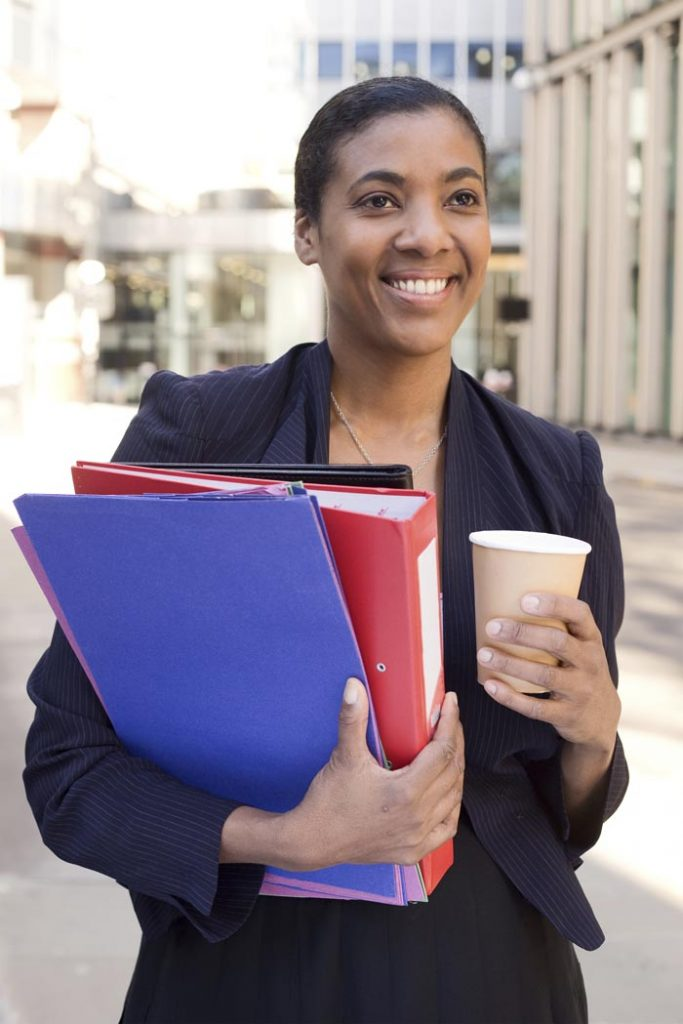 Business woman with a coffee and folders.